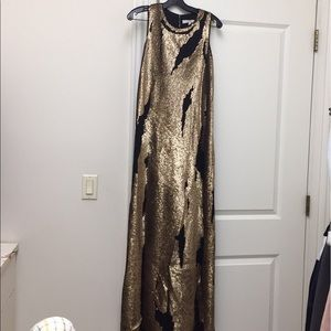 Spectacular Gold sequined distresses Black gown
